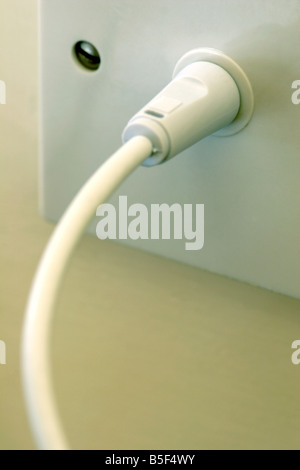 Aerial plugged into wall socket close up - Stock Photo