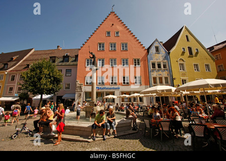 fountain and street restaurant on the market square in Fuessens old town Fuessen Allgaeu Bavaria Germany - Stock Photo