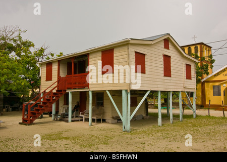 CAYE CAULKER BELIZE Traditional wooden cottage on stilts with shutters - Stock Photo