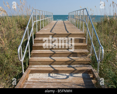 A wooden stairway and boardwalk leads across the sand dunes to the main beach at Myrtle Beach State Park, South - Stock Photo