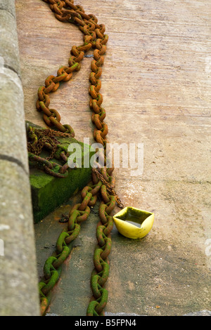 An old, rusty mooring chain. - Stock Photo