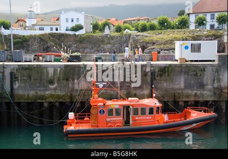 Maritime rescue vessel in the harbor at Llanes Asturias Spain - Stock Photo