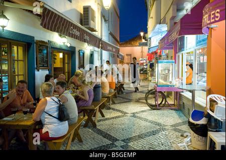 Street scene in Alvor at Dusk , Algarve , Portugal - Stock Photo