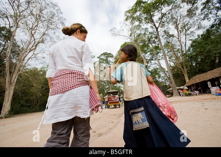 Children selling postcards guidebooks at Angkor Wat temples, Siem Reap, Cambodia - Stock Photo