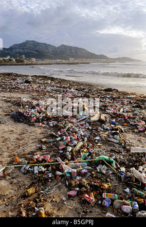 Human waste is washed ashore after a storm on the Corniche in Marseille, France. - Stock Photo