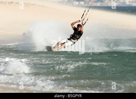 man kitesurfing in tarifa, cadiz, andalusia, spain - Stock Photo