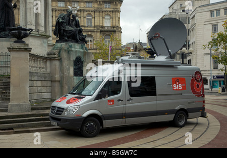 SIS outside broadcast van with satellite dish up - Stock Photo