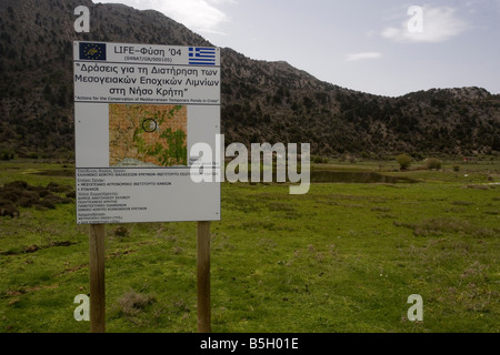 Temporary Pond on the Omalos plateau White Mountains Crete rare habitat EU protected Information board - Stock Photo
