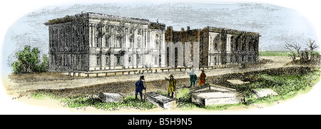 Ruins of the US Capitol after the British burned Washington DC during the War of 1812. Hand-colored woodcut - Stock Photo