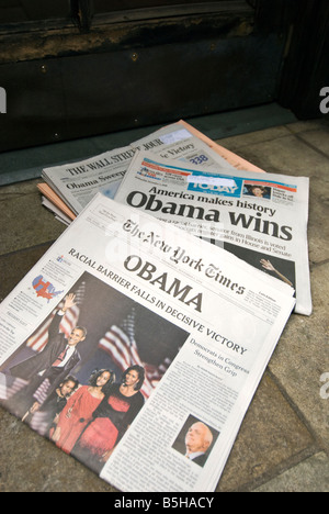 New York newspapers delivered to the front door announcing Barack Obama's historic presidential win in 2008. - Stock Photo