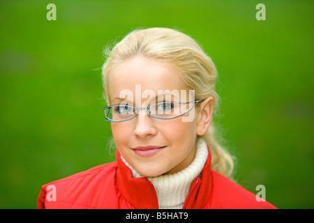 Blonde Frau im Herbst, blonde woman in autumn - Stock Photo