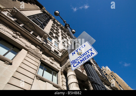 Notice of NYPD security camera on post in front of building Manhattan New York City USA - Stock Photo