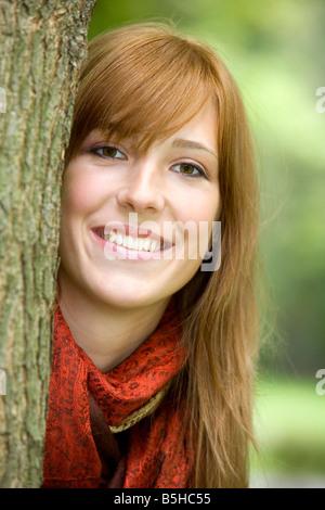 Junge rothaarige Frau im Herbst, Portrait oh redheaded woman in autumn - Stock Photo