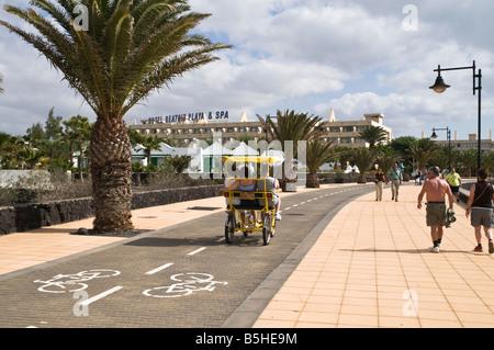 dh Playa Matagorda MATAGORDA LANZAROTE Family riding four wheel buggy on cyclepath people cycling cycle path - Stock Photo