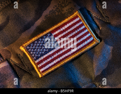 Detachable US flag patch on military camouflage fabric - Stock Photo