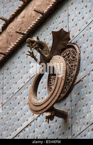 Gothic door knocker on the doorway of La Lonja de la Seda formally a commodity exchange in Valencia Spain - Stock Photo