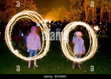 Two Young Children, Playing with Sparklers on Bonfire Night, Northwich, Cheshire, England, UK - Stock Photo