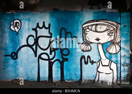 A piece of graffiti in a brownfield site factory. Mural. Graffiti dans une usine désaffectée. - Stock Photo