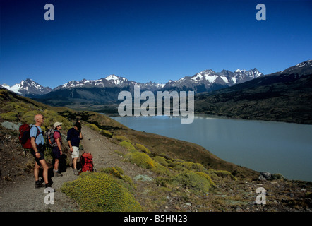 Trekkers looking at view over Lake Paine, Torres del Paine circuit, Patagonia, Chile - Stock Photo