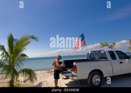 Miami Beach Florida Beach Chicken business owner duct tapes