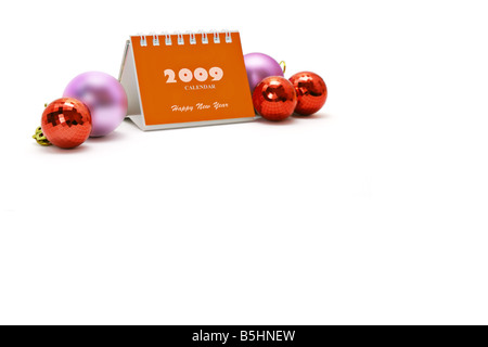 2009 desktop calendar and Christmas ornaments with copy space - Stock Photo