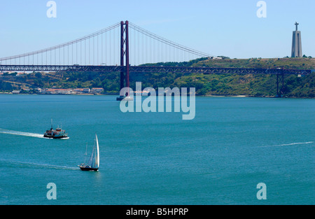 Ponte 25 de Abril and Monumento Christo Rei, Lisbon, Portugal - Stock Photo