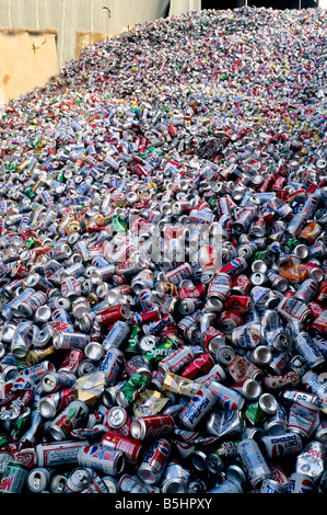 Piled aluminum soft drink cans at recycle center. - Stock Photo