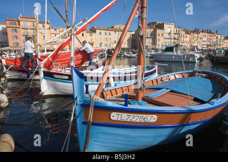 Sailing boats are situated in the port of Saint-Tropez at the Cote d'Azur / Provence / Southern France - Stock Photo