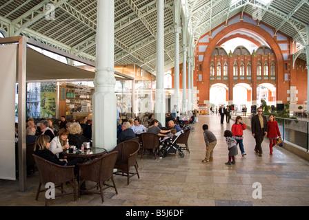 Cafe inside former market hall Mercado de Colón in the city of Valencia Spain - Stock Photo