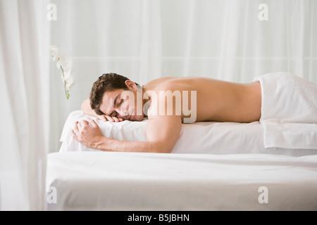 man lying on massage bench - Stock Photo