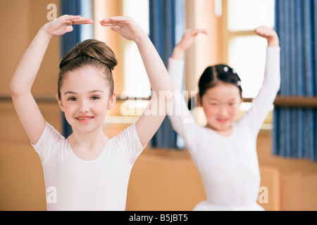 tow young girls dancing ballet - Stock Photo