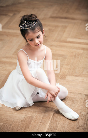 portrait of young ballet dancer wearing little crown - Stock Photo