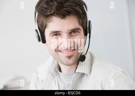 portrait of man wearing headset - Stock Photo