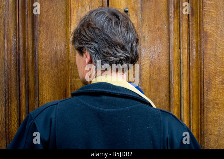 Man by the door Strasbourg june 2006 - Stock Photo