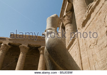 A falcon granite statue of Horus at the Hypostyle Hall in Edfu temple dedicated to falcon god Horus, built during - Stock Photo