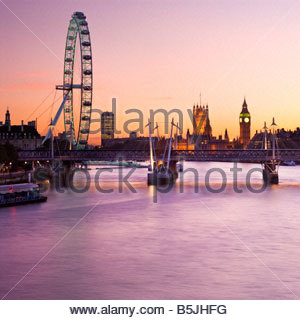 The London Eye and the Houses of Parliament, London, England. - Stock Photo