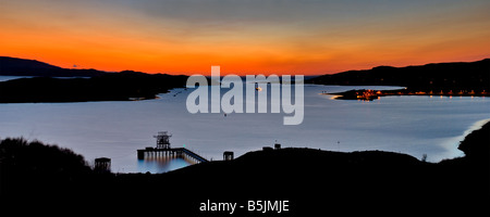 Sunset over Aultbea, Isle of Ewe and the Nato refuelling station. Taken from the viewpoint along the A832, Wester - Stock Photo