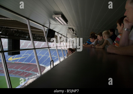 Barcelona football fans looking out over the pitch from the commentators gantry, CAMP NOU FC BARCELONA FOOTBALL - Stock Photo