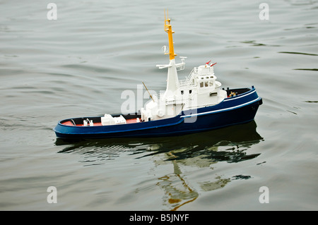 Model radio controlled boat on water. - Stock Photo