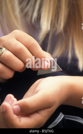 teenage girl cutting wrist with razor blade Stock Photo ...