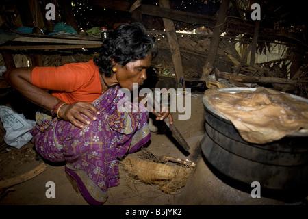 Rasamball makes and sells idly (a food) in her bamboo shack at HAI Kandakadu village TamilNadu - Stock Photo