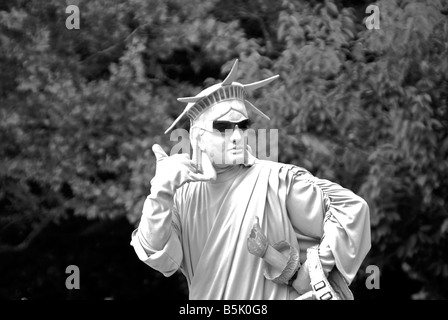 A mime at Battery Park in New York depicting Lady Liberty - Stock Photo