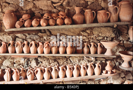 simple pottery on a reck - Stock Photo
