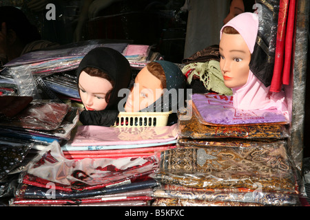 Headscarves for women on sale in shop in Southall Broadway London - Stock Photo