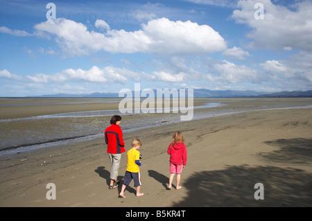 Family on Collingwood Beach Golden Bay Nelson Region South Island New Zealand - Stock Photo