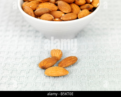Bowl Of Fresh Healthy Almond Nuts With No People And A Clipping Path - Stock Photo