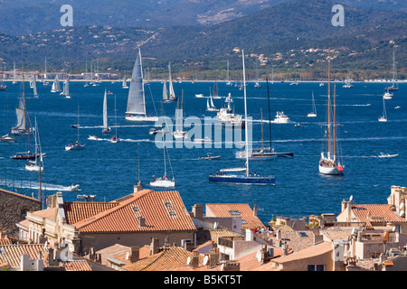A view over the roofs of Saint Tropez / Cote d'Azur / Provence / Southern France down to the bay of Saint-Tropez - Stock Photo