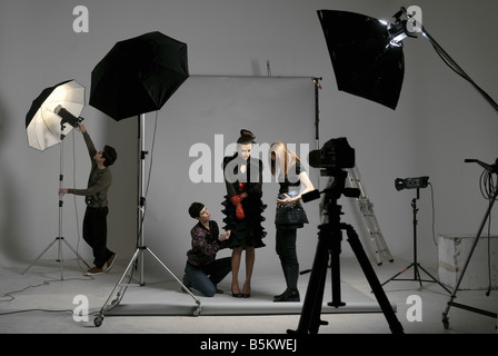 Professionals on fashion shooting set - Stock Photo