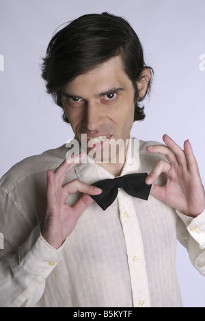 Portrait of a young man with a bow tie. - Stock Photo