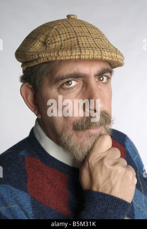 Middle aged man in golf cap.